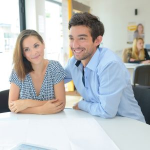 Young couple with property developer